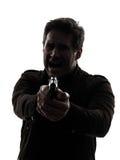 Mężczyzna zabójcy policjanta celowania pistoletu sylwetka Fotografia Stock