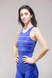 Jeden młoda kobieta, pusty wyrażenie, pływaczki swimsuit zdjęcie royalty free