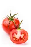 Jeden pełny pomidor i jedna druga pomidorów fotografia stock