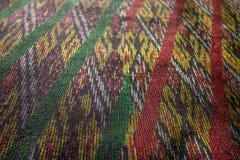 Jedwab jedwabniczej tkaniny dzianiny wzoru tekstury deseniowy Tajlandzki bezszwowy tło Zdjęcie Royalty Free