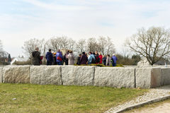 JEDWABNE - APRIL 6: Peoples at the monument of Jewish massacre in Jedwabne, Poland on April 6, 2014 Royalty Free Stock Photos
