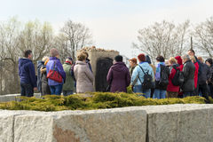 JEDWABNE - APRIL 6: Peoples at the monument of Jewish massacre in Jedwabne, Poland on April 6, 2014 Stock Photos