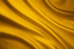 Jedwabniczej tkaniny fala tło, Żółta Atłasowa Sukienna tekstura zdjęcie royalty free