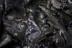 Jedwabniczy czarny i złocisty fabrick Fotografia Royalty Free