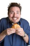jedząc człowieka hamburgera Zdjęcia Stock