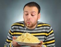 Jedzenie i facet Fotografia Stock
