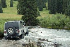 Jeep 15. Jeep driving through a mountain stream Stock Photos