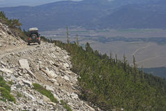 Jeep 25. Jeep driving around a mountain curve Royalty Free Stock Photos