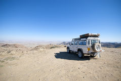 Jeep adventure. White jeep exploring the desert landscape in Namibia, Southern Africa Stock Images