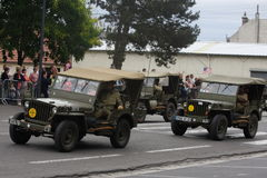 Jeep americana della seconda guerra mondiale che sfoggia per la festa nazionale del 14 luglio, Francia Immagine Stock Libera da Diritti