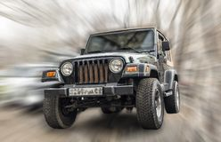 JEEP car. Jeep car cross-country, on a blurred background in motion royalty free stock images