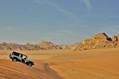 Jeep car in desert. White jeep car in rocky desert Stock Image