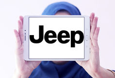 Jeep car logo. Logo of jeep car brand on samsung tablet holded by arab muslim woman stock photo