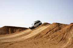 Jeep car in Sahara. Jeep car in stone desert Stock Photo