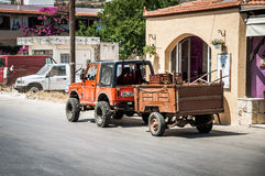 Jeep car with small cargo trailer at street of Paleochora town Royalty Free Stock Photo