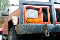Jeep Cherokee after a muddy ride Royalty Free Stock Photos