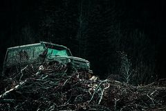 Jeep crashed into a puddle and picked up a spray of dirt. Off road sport truck between mountains landscape. Expedition. Offroader. Motion the wheels tires and stock photos