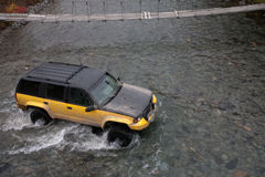 Jeep crossing a river Stock Images
