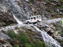 Jeep crossing waterfal in Marsyangdi valley near Dharapani - Nepal Stock Photos