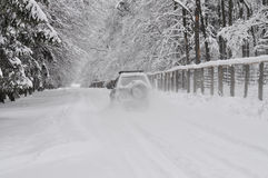 Jeep on dangerous winter road Royalty Free Stock Photos