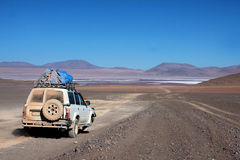 Jeep in the desert in bolivia Stock Photos
