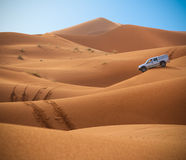 Jeep and Desert Dunes. Jeep in the Sahara - Desert Dunes - Morocco in the morning Stock Photo