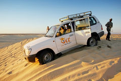 Jeep in desert Sahara Royalty Free Stock Image