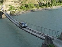 A jeep drives over a rope bridge over a river. In Turkey d.y Stock Photo