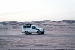 Jeep driving in sand dunes in desert, Hurghada, Egypt stock photography