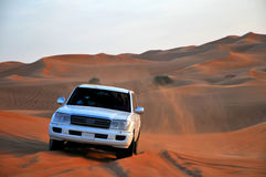 Jeep in dunes Stock Photo