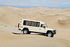Jeep in the dunes of the Namib Desert, Namibia Royalty Free Stock Images