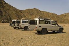 Jeep in egyptian desert. White explorer jeep standing still in the desert, Egypt Royalty Free Stock Photography