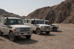 Jeep in egyptian desert. White explorer jeep standing still in the desert, Egypt Royalty Free Stock Image