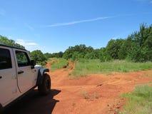 Jeep en Oklahoma del parque del camino Foto de archivo
