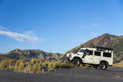 Jeep at foot of mountain Stock Images