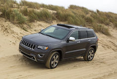 Jeep Grand Cherokee unbranded. Grand Cherokee Diesel 4x4 in the sand Stock Photo