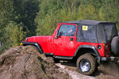 Jeep on the hard road. Off road amateur competition in Poland Stock Photography