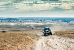 Jeep on Kharkov desert background Royalty Free Stock Images
