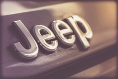 Jeep metal emblem. Close up photograph of a metal Jeep badge or emblem Royalty Free Stock Photos