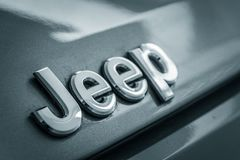 Jeep metal emblem. Close up photograph of a metal Jeep badge or emblem Stock Image