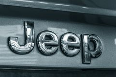 Jeep metal emblem. Close up photograph of a metal Jeep badge or emblem Royalty Free Stock Photography