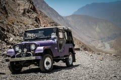 Jeep on a mountain road Stock Photos