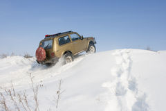 Jeep Niva snow. Lada Niva jeep rides on the snow-covered hill. The sign on the rear window is not copyright stock photos
