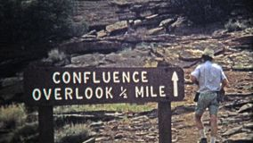 1971: Jeep offroad driving to the Confluence Canyon Overlook. stock video footage