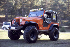 Jeep Offroad Truck. Offroad truck jeeep is in the image. Truck has big tires and trees at background Stock Photography
