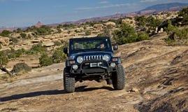 Jeep op Utah Slickrock Stock Foto's