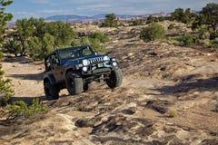 Jeep op Utah Slickrock Stock Afbeeldingen