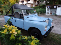 A jeep parked on bequia. A freshly painted blue jeep parked on bequia in the caribbean Stock Image