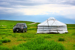 Jeep parked next to yurt Stock Images