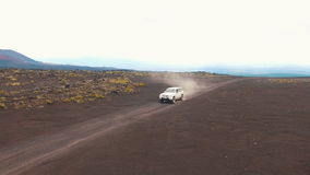 Jeep rides near the volcano. Circling to copter SUV. Eruption stock video